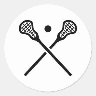 El lacrosse cruzado pega la bola pegatina redonda