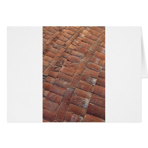 El ladrillo camina textura del fondo tarjeta de felicitación
