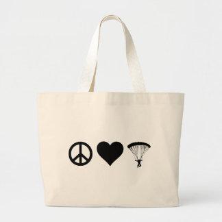 El lanzarse en paracaídas del amor de la paz bolsa de tela grande