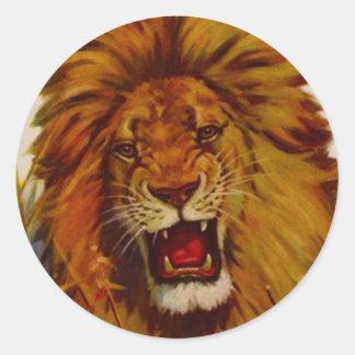 El león de la fauna del pegatina gruñe los