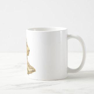 El león y la señora taza de café