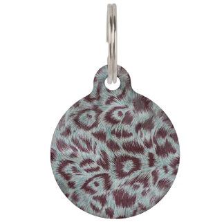 El leopardo peludo exótico mancha la berenjena placa para mascotas
