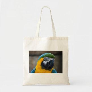 el macaw del azul y del oro repite mecánicamente l bolsas de mano
