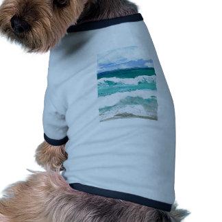 El mar de baile del océano de las ondas agita los  prenda mascota