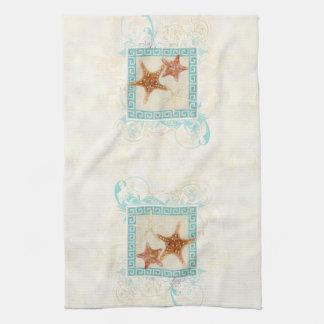 El mar de las estrellas de mar descasca la playa g toalla de cocina