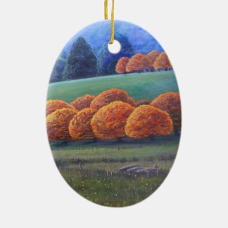 El marzo de los árboles de roble brillantes adorno navideño ovalado de cerámica
