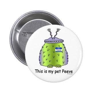 El mascota Peeve el botón