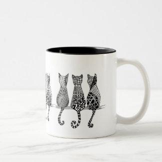 El maullido del gato taza de café de dos colores