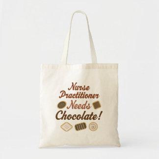 El médico de la enfermera necesita el chocolate bolsa