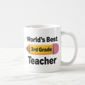 El mejor 3ro lápiz del profesor del grado de los taza