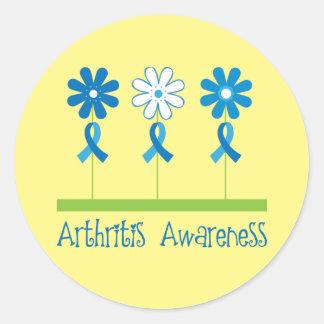 El mes de la conciencia de la artritis floreció a pegatina redonda