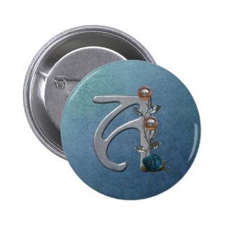 El metal florece el monograma A Pins