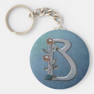 El metal florece el monograma B Llavero