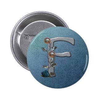 El metal florece el monograma F Pins
