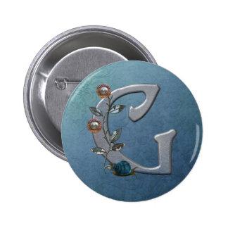 El metal florece el monograma G Pin