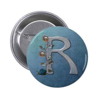 El metal florece el monograma R Pins