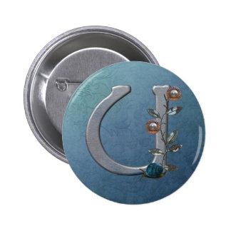 El metal florece el monograma U Pin