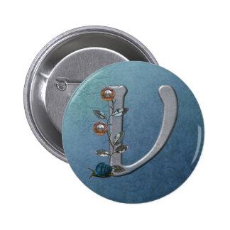 El metal florece el monograma V Pins