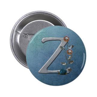 El metal florece el monograma Z Pins