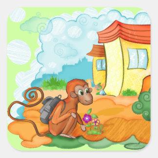 El mono con la cola larga embroma al pegatina