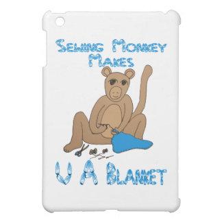 El mono de costura hace U una manta
