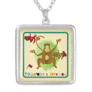 El mono de Trinidad y de Trinidad y Tobago ve el Colgante Cuadrado