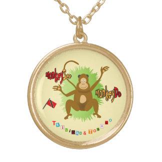 El mono de Trinidad y de Trinidad y Tobago ve el Colgante Redondo