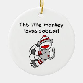 El mono del calcetín ama las camisetas y los regal ornamento de reyes magos