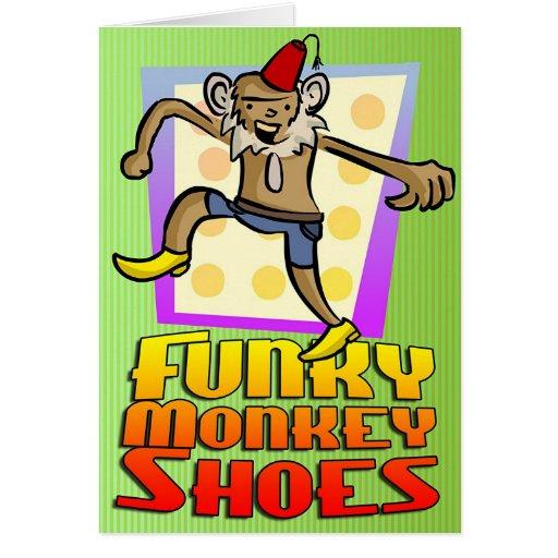 ¡El mono enrrollado calza la tarjeta de felicitaci