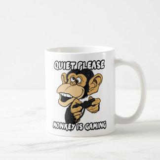 El mono es juego tazas de café