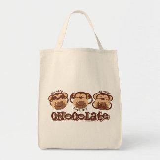 El mono ve el chocolate bolsas de mano