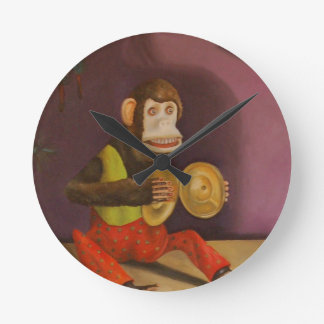 El mono ve el mono hacer reloj de pared