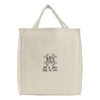 El monograma del boda nombra el bolso de la invita bolsas de mano bordadas