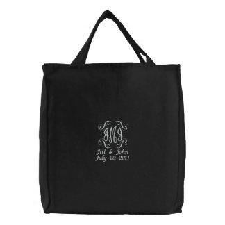 El monograma del boda nombra el bolso del negro de bolsas bordadas