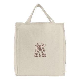 El monograma del boda nombra la bolsa de asas de