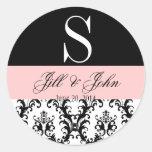 El monograma del boda nombra rosa del negro del etiqueta redonda