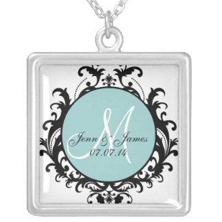 El monograma del damasco nombra el collar de la fe