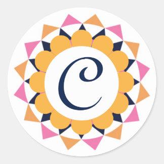 El monograma geométrico popular embroma a los pegatina redonda