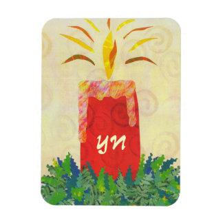 El monograma que destella de la luz de una vela imán de vinilo