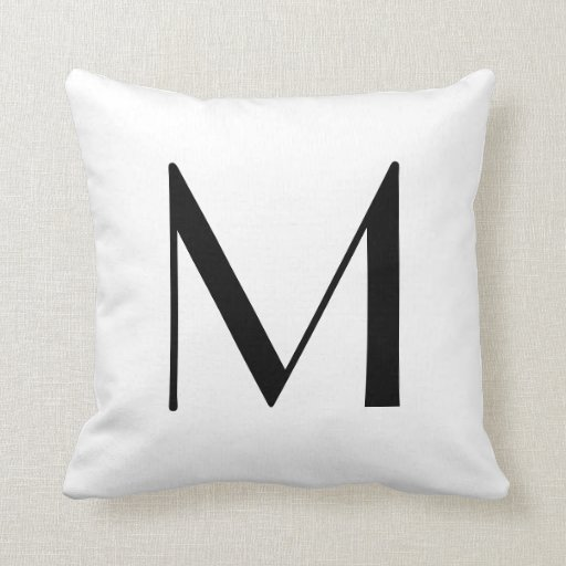 El monograma soporta la letra M Cojin