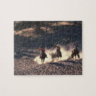 El montar de los vaqueros rompecabeza con fotos
