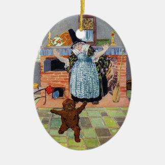 El muchacho del pan de jengibre salta del horno adorno ovalado de cerámica