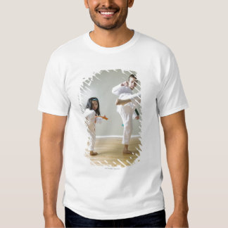 El muchacho y el chica (4-9) el Taekwondo Remera