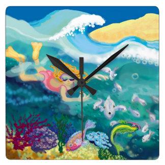 El nadar con los pescados reloj cuadrado