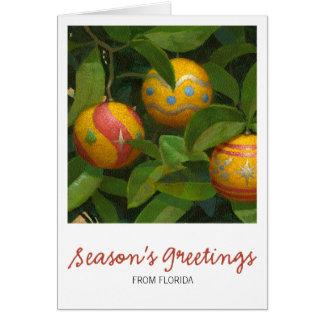 El naranja adorna la tarjeta de Navidad
