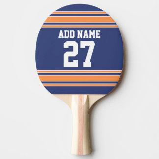 El naranja azul se divierte el jersey con su nombr pala de ping pong