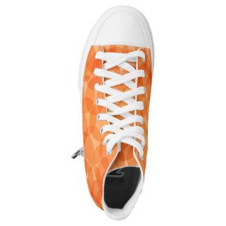 El naranja circunda los zapatos del top del alto zapatillas
