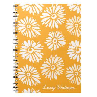 El naranja florece el cuaderno