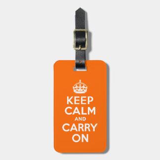 El naranja guarda calma y continúa etiquetas maletas