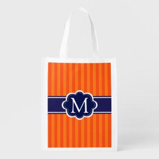 El naranja raya inicial de encargo del monograma bolsas de la compra